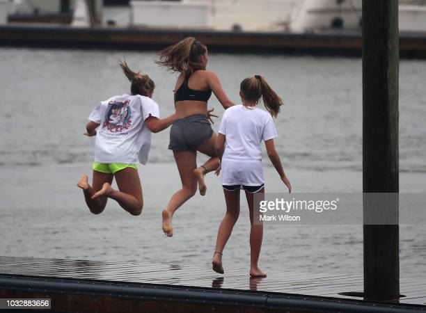 Carson Grace Toomer MartinMaine Wrangel and Elizabeth Claire Toomer jump into the Intracoastal Waterway as Hurricane Florence approaches the area on...