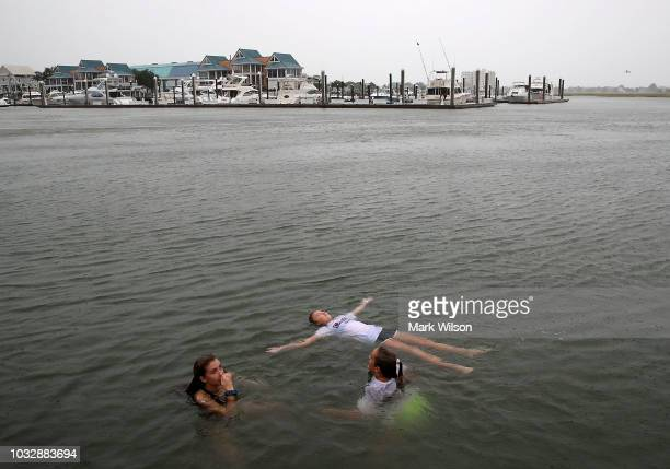 Carson Grace Toomer MartinMaine Wrangel and Elizabeth Claire Toomer swim in the Intracoastal Waterway as Hurricane Florence approaches the area on...