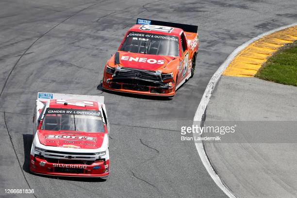 Carson Hocevar, driver of the Scott's Chevrolet, leads Derek Kraus, driver of the ENEOS Toyota, during the NASCAR Gander RV & Outdoors Truck Series...