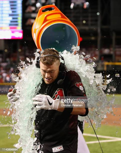 Carson Kelly of the Arizona Diamondbacks is dunked with gatorade after hitting a walkoff RBI single against the Boston Red Sox during the ninth...