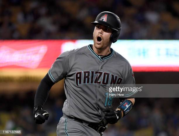 Carson Kelly of the Arizona Diamondbacks reacts to his solo homerun, his second of the evening, to take a 3-2 lead over the Los Angeles Dodgers,...