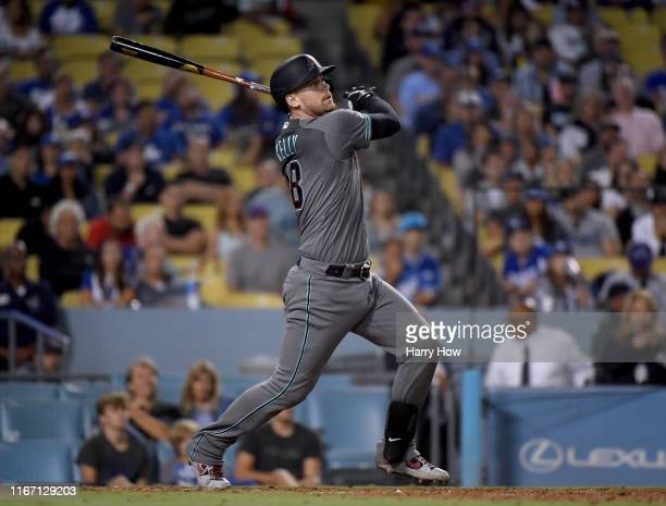 Carson Kelly of the Arizona Diamondbacks watches his two run homerun to tie the game 22 during the ninth inning at Dodger Stadium on August 09 2019...
