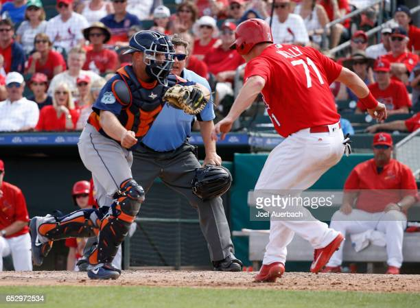 Carson Kelly of the St Louis Cardinals is called out at home as he avoids the tag by Max Stassi of the Houston Astros by running out of the base path...