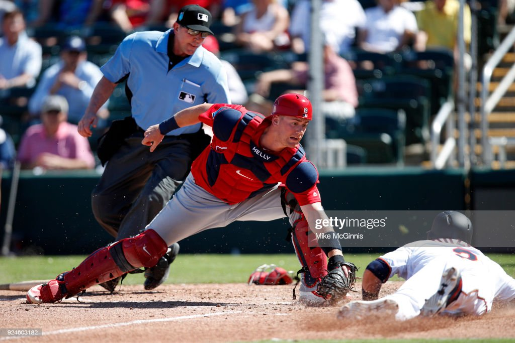 Carson Kelly #19 of the St. Louis Cardinals tags out Brian Dozier #2 of the Minnesota Twins during the third inning of the Spring Training game against the Minnesota Twins at Hammond Stadium on February 26, 2018 in Fort Myers, Florida.