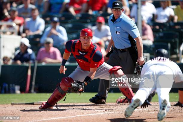 Carson Kelly of the St Louis Cardinals tags out Brian Dozier of the Minnesota Twins during the third inning of the Spring Training game against the...