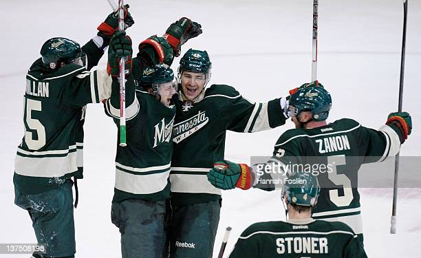 Carson McMillan, Chad Rau, Jed Ortmeyer and Greg Zanon of the Minnesota Wild celebrate a goal by Rau in the second period on January 21, 2012 at Xcel...