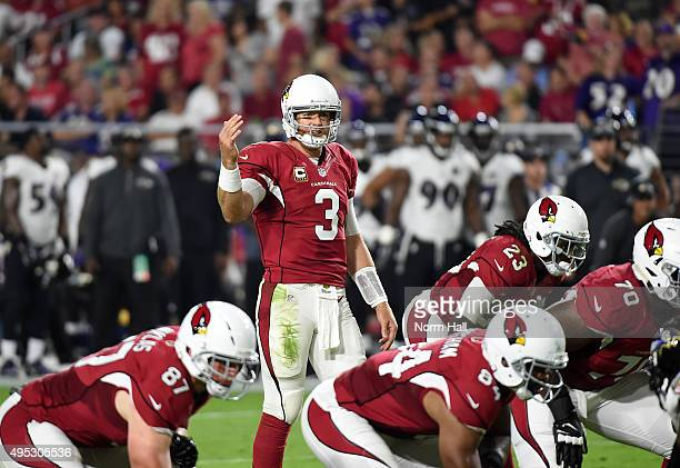 Carson Palmer of the Arizona Cardinals calls signals from the line of scrimmage against the Baltimore Ravens at University of Phoenix Stadium on...