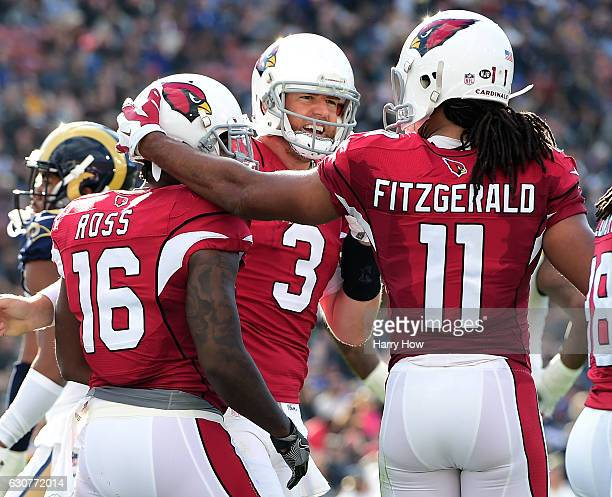 Carson Palmer of the Arizona Cardinals celebrates his touchdown pass to Jeremy Ross with Larry Fitzgerald to take a 130 lead over the Los Angeles...