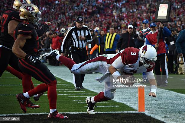 Carson Palmer of the Arizona Cardinals dives into the end zone for a sevenyard rushing touchdown against the San Francisco 49ers during their NFL...