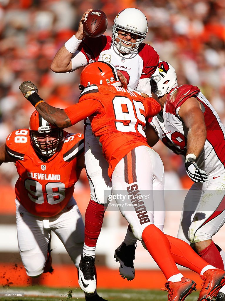Carson Palmer #3 of the Arizona Cardinals is hit while throwing a second quarter pass by Armonty Bryant #95 of the Cleveland Browns at FirstEnergy Stadium on November 1, 2015 in Cleveland, Ohio. Arizona won the game 34-20.