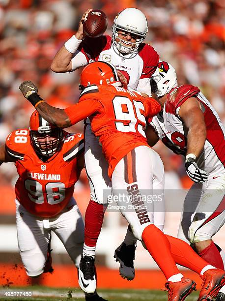 Carson Palmer of the Arizona Cardinals is hit while throwing a second quarter pass by Armonty Bryant of the Cleveland Browns at FirstEnergy Stadium...
