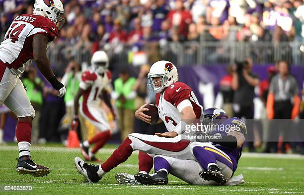 Carson Palmer of the Arizona Cardinals is sacked by Brian Robison of the Minnesota Vikings in the second half of the game on November 20, 2016 at US...