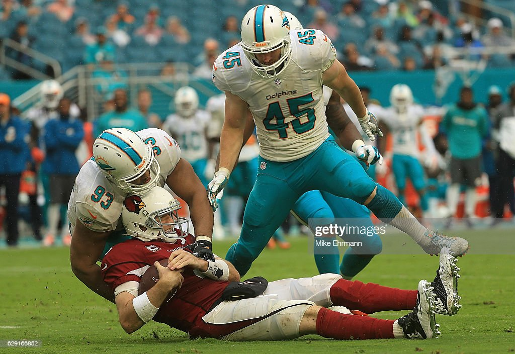 Carson Palmer #3 of the Arizona Cardinals is tackled by Ndamukong Suh #93 of the Miami Dolphins during a game at Hard Rock Stadium on December 11, 2016 in Miami Gardens, Florida.