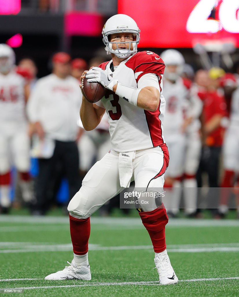 Carson Palmer #3 of the Arizona Cardinals looks to pass against the Atlanta Falcons at Mercedes-Benz Stadium on August 26, 2017 in Atlanta, Georgia.