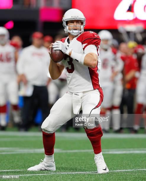 Carson Palmer of the Arizona Cardinals looks to pass against the Atlanta Falcons at MercedesBenz Stadium on August 26 2017 in Atlanta Georgia