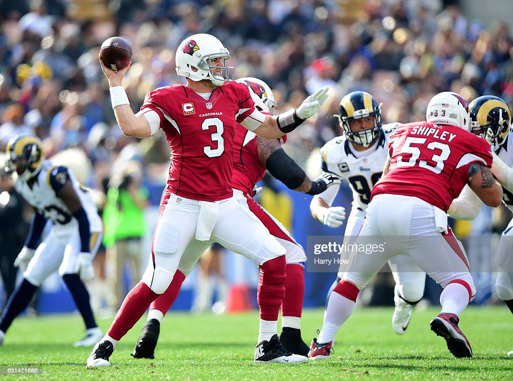 Carson Palmer #3 of the Arizona Cardinals makes a pass during the game against the Los Angeles Rams at Los Angeles Memorial Coliseum on January 1, 2017 in Los Angeles, California.