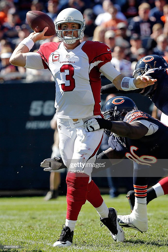Carson Palmer #3 of the Arizona Cardinals passes while under pressure by Jarvis Jenkins #96 of the Chicago Bears during the fourth quarter at Soldier Field on September 20, 2015 in Chicago, Illinois.