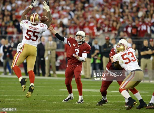 Carson Palmer of the Arizona Cardinals throws the ball down field over a leaping Ahmad Brooks of the San Francisco 49ers at University of Phoenix...
