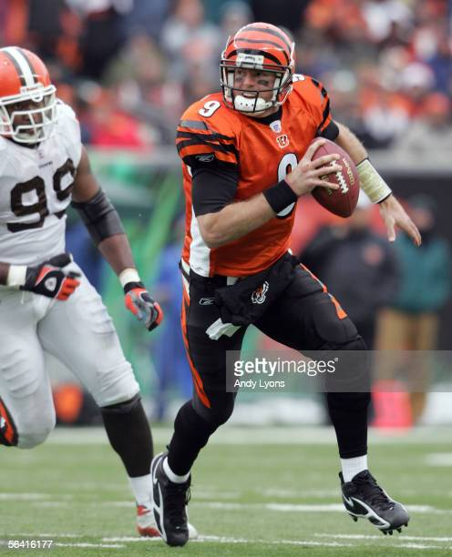 Carson Palmer of the Cincinnati Bengals is chased by Orpheus Roye of the Cleveland Browns during the NFL game at Paul Brown Stadium on December 11...