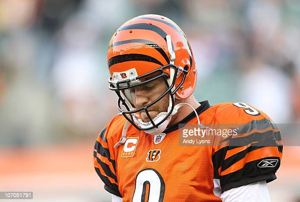 Carson Palmer of the Cincinnati Bengals walks off of the field after throwing an interception late in the fourth quarter of the Bengals 49-31 loss to...