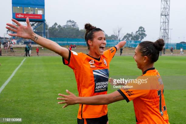 Carson Pickett of the Roar and Allira Toby celebrate after they beat the Wanderers during the round nine WLeague match between the Western Sydney...