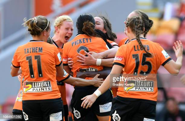Carson Pickett of the Roar celebrates with team mates after scoring a goal during the round one WLeague match between the Brisbane Roar and the Perth...