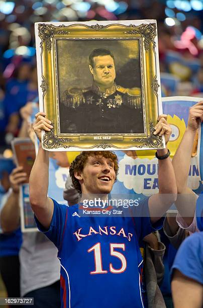 Carson Rufledt holds up a faux panting of Kansas Jayhawks head coach Bill Self during the game against the West Virginia Mountaineers at Allen...
