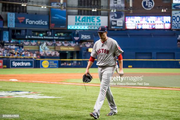 Carson Smith of the Boston Red Sox reacts after allowing six runs during the eighth inning of the Opening Day game against the Tampa Bay Rays on...