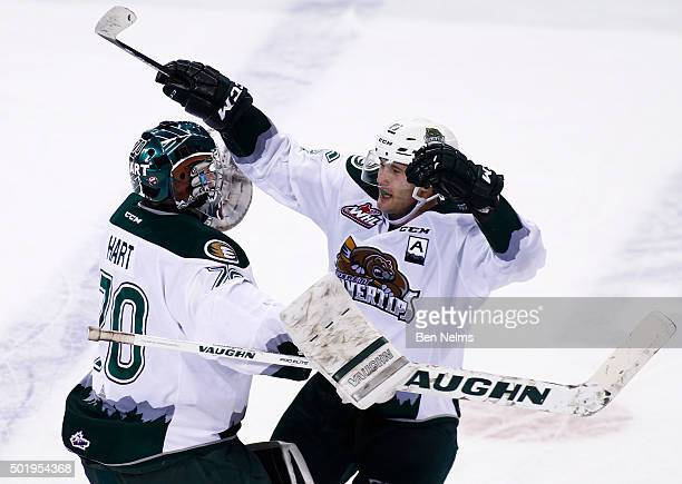 Carson Stadnyk of the Everett Silvertips celebrates his game winning goal against the Vancouver Giants with goaltender Carter Hart during overtime of...