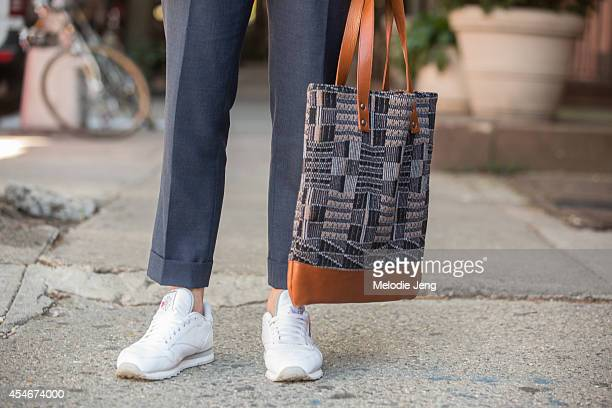 Carson Street Clothiers cofounder Brian Trunzo wears a Carson Street Clothiers suit Salvatore Piccolo shirt Missoni bag Reebok classic sneakers and...
