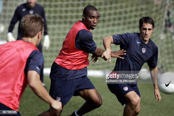 Eddie Pope and Josh Wolff battle for ball possession 03 February during a practice session of the US Men's National Soccer Team at their training...
