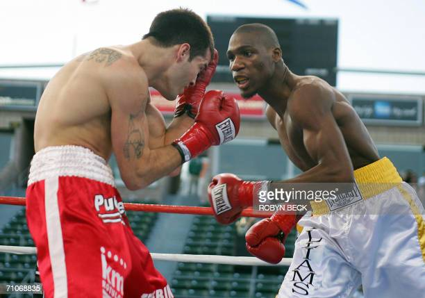 USA's Paul Williams pressures Argentina's Walter Dario Matthysse in their Welterweight NABO title bout at the Home Depot Center in Carson CA 27 May...