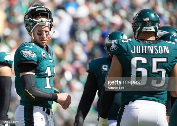 Carson Wentz and Lane Johnson of the Philadelphia Eagles look on against the New York Giants at Lincoln Financial Field on September 24 2017 in...