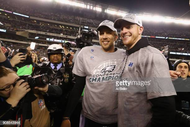 Carson Wentz and Nick Foles of the Philadelphia Eagles celebrate their teams win over the Minnesota Vikings in the NFC Championship game at Lincoln...