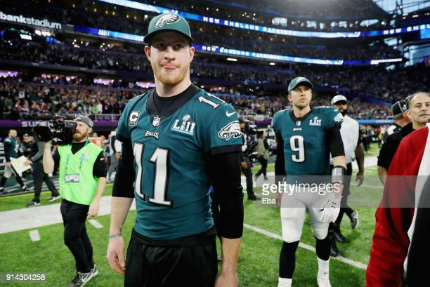 Carson Wentz and Nick Foles of the Philadelphia Eagles take the field prior to Super Bowl LII against the New England Patriots at US Bank Stadium on...