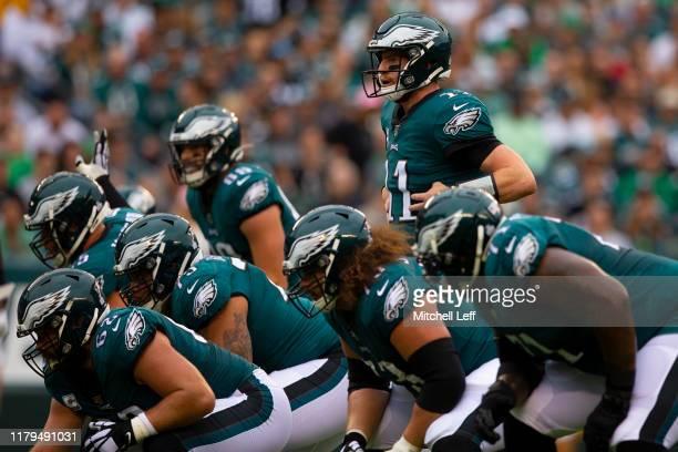 Carson Wentz, Lane Johnson, Brandon Brooks, Jason Kelce, Isaac Seumalo and Jason Peters of the Philadelphia Eagles in action against the New York...