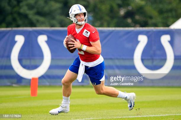 Carson Wentz of the Indianapolis Colts rolls out to throw a pass during the Indianapolis Colts Training Camp at Grand Park on July 28, 2021 in...
