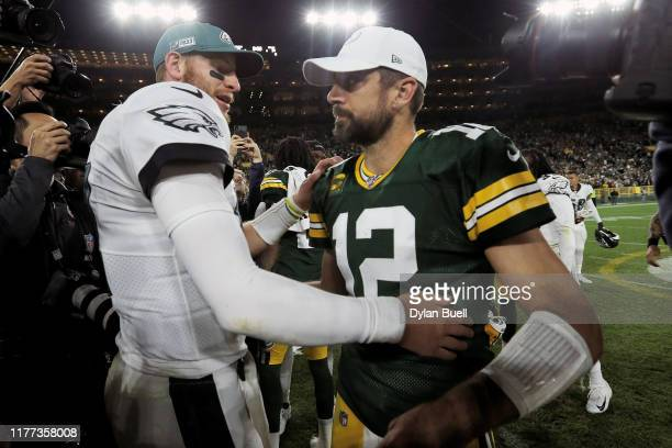 Carson Wentz of the Philadelphia Eagles and Aaron Rodgers of the Green Bay Packers meet after the Eagles beat the Packers 34-27 at Lambeau Field on...