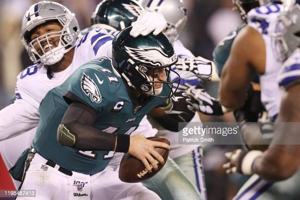 Carson Wentz of the Philadelphia Eagles avoids pressure during the second half against the Dallas Cowboys in the game at Lincoln Financial Field on...