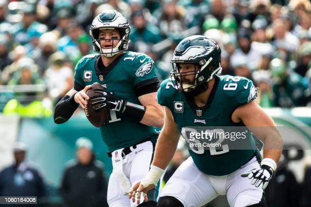 Carson Wentz of the Philadelphia Eagles drops back to pass behind Jason Kelce during the first quarter against the Carolina Panthers at Lincoln...