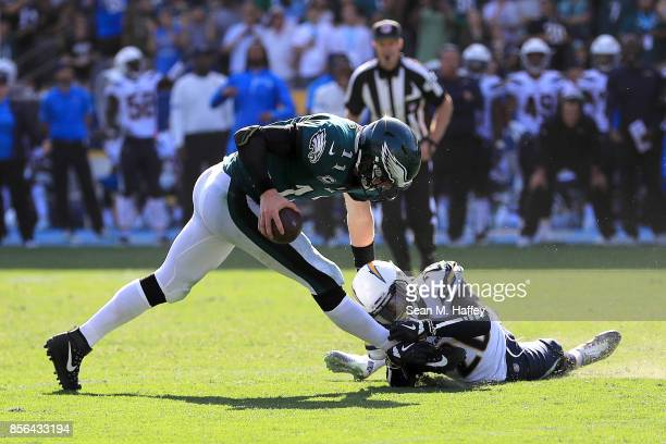Carson Wentz of the Philadelphia Eagles eludes Desmond King of the Los Angeles Chargers during the second half of a game at StubHub Center on October...