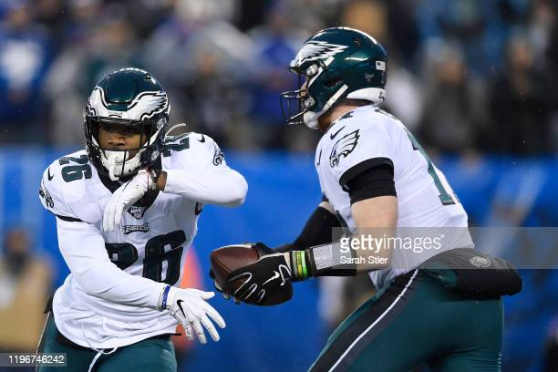 Carson Wentz of the Philadelphia Eagles fakes the hand-off to Miles Sanders during the first half of the game against the New York Giants at MetLife...