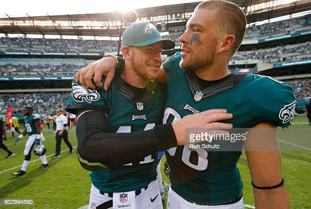 Carson Wentz of the Philadelphia Eagles gets a hug by Zach Ertz after defeating he Cleveland Browns 2910 during a game at Lincoln Financial Field on...