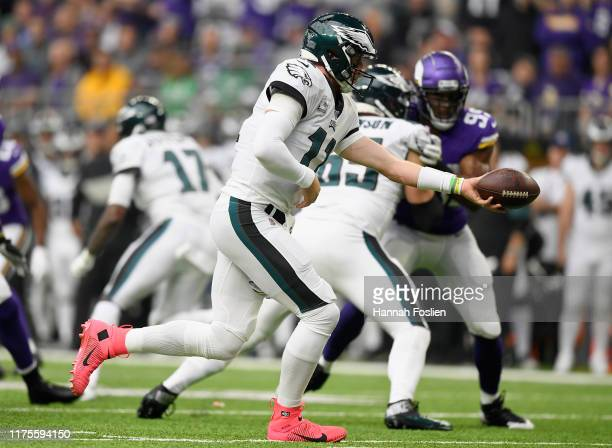 Carson Wentz of the Philadelphia Eagles hands off the ball against the Minnesota Vikings during the first quarter of the game at US Bank Stadium on...