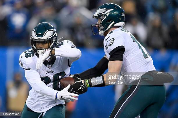 Carson Wentz of the Philadelphia Eagles hands the ball off to Miles Sanders against the New York Giants during the first quarter in the game at...