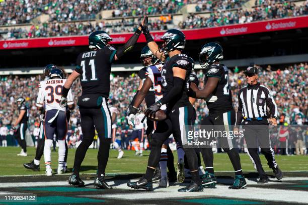 Carson Wentz of the Philadelphia Eagles high fives Zach Ertz after Ertz scored a touchdown against the Chicago Bears in the second quarter at Lincoln...