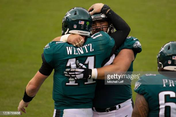 Carson Wentz of the Philadelphia Eagles hugs Jason Kelce after scoring a touchdown against the Cincinnati Bengals in the fourth quarter at Lincoln...