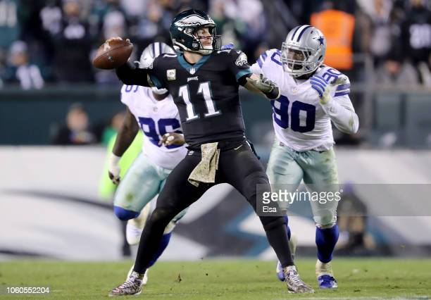 Carson Wentz of the Philadelphia Eagles is pressured by Demarcus Lawrence and Maliek Collins of the Dallas Cowboys on November 112018 at Lincoln...