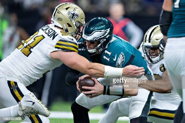 Carson Wentz of the Philadelphia Eagles is sacked by Trey Hendrickson of the New Orleans Saints in the second half at MercedesBenz Superdome on...