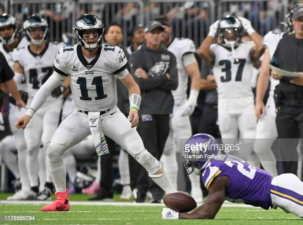 Carson Wentz of the Philadelphia Eagles looks on as Xavier Rhodes of the Minnesota Vikings attempts to intercept the ball during the second quarter...
